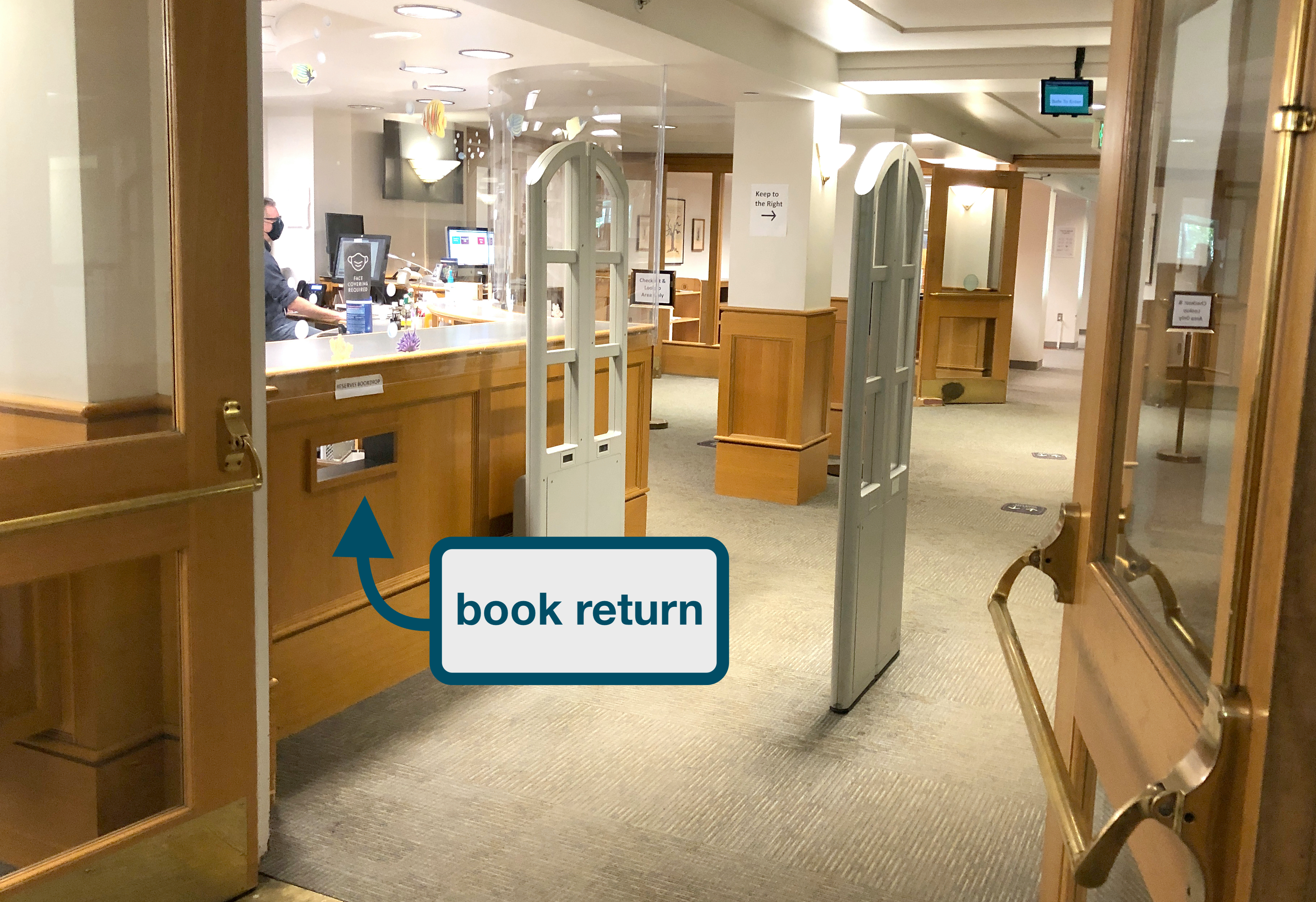 "library book return with arrow and label ""book return"""