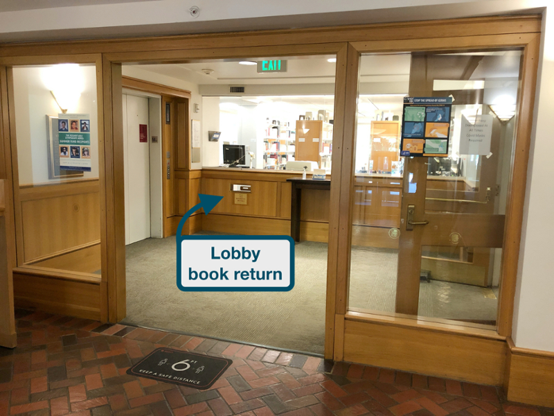 photo of the library lobby book return, circled with an arrow pointing toward the book return
